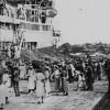 StateLibQld_1_103501_Crowds_on_a_Brisbane_wharf_farewell_a_passenger_ship,_ca._1937