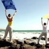 stock-footage-couple-with-waving-sarong-standing-on-the-seashore-slow-motion-shot-at-fps