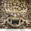 stock-photo-ancient-wall-temple-stone-carvings-bali-traditional-garuda-33085114